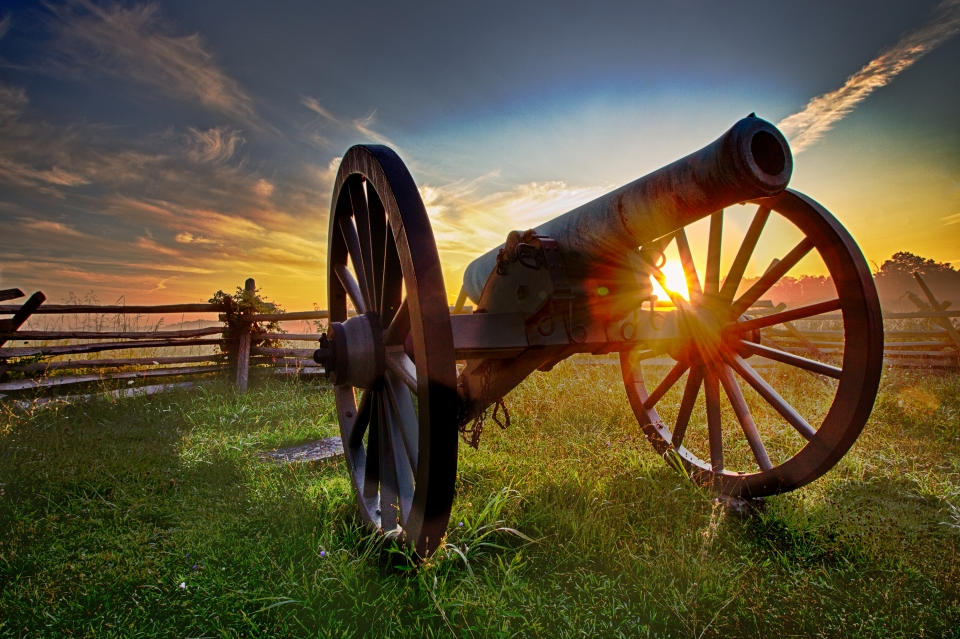 A cannon against a backdrop of the sunset at Gettysburg